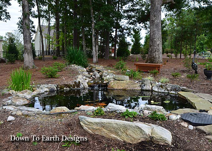 Beautiful raleigh landscape designs with koi ponds nc for Earth designs landscaping